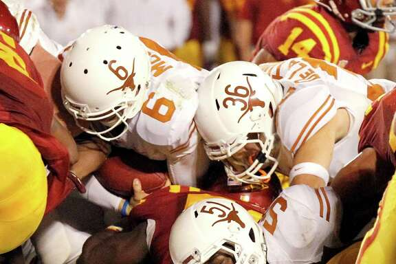 Texas quarterback Case McCoy (6) sneaks across the goal line from a yard out with 51 seconds remaining to help give the Longhorns a 31-30 Big 12 victory over Iowa State at Ames on Thursday night. C3