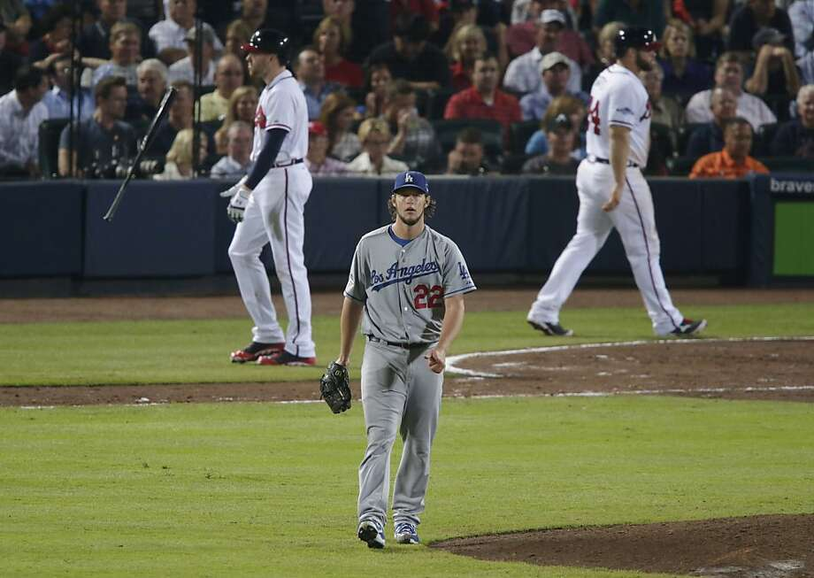Braves first baseman Freddie Freeman flips his bat after becoming one of Clayton Kershaw's strikeout victims. Kershaw fanned a dozen and gave up three hits over seven innings. Photo: Dave Martin, Associated Press