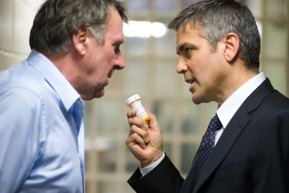"Tom Wilkinson and George Clooney in  ""Michael Clayton.""  Topical, timeless, one great signature performance (Clooney), one incredibly memorable scene (the end), not sure about the overarching consciousness, and the complex finish may be the result simply of the way the last shot is filmed.  Classic? Possibly yes, in the same way that Bogart's best movies are. Classic because it's future classic Clooney. Photo: Myles Aronowitz, AP"