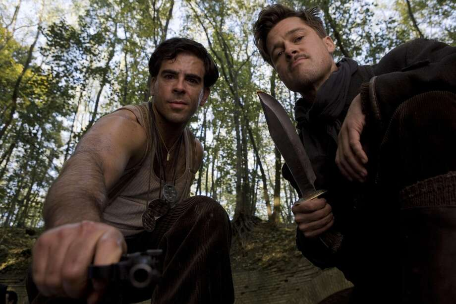 "Eli Roth and Brad Pitt in ""Inglourious Basterds.""  Not necessarily topical, but five of the last six categories, including MANY memorable scenes, and two great performances (Waltz and Laurent). Classic?  YES. Photo: Weinstein Co."
