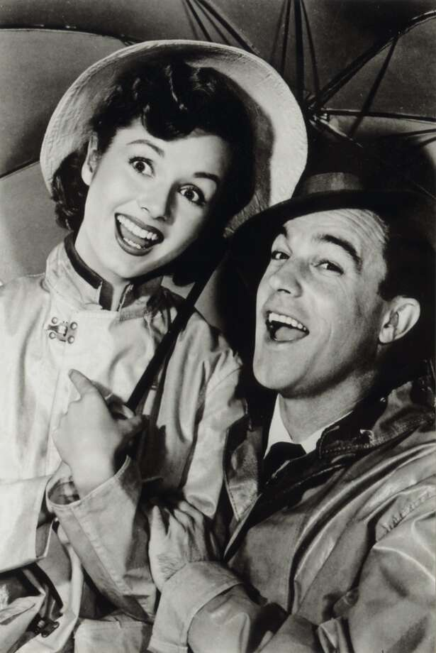 "Debbie Reynolds and Gene Kelly in ""Singing In The Rain.""  Not topical.  Timeless.  Great performances, perhaps, of a KIND. Memorable scenes, one beyond memorable -- iconic.  Not much of an overarching conciousness.  Not a complex finish.  Classic?  Apparently. Photo: Handout"