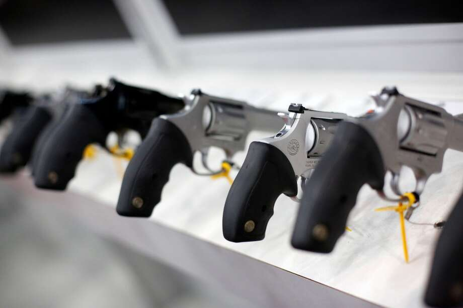 A row of revolvers is seen, during day 1 of the 142nd NRA annual meetings and exhibits, Friday, May 3, 2013 at the George R Brown convention center in  (TODD SPOTH FOR THE CHRONICLE) Photo: © TODD SPOTH, 2013