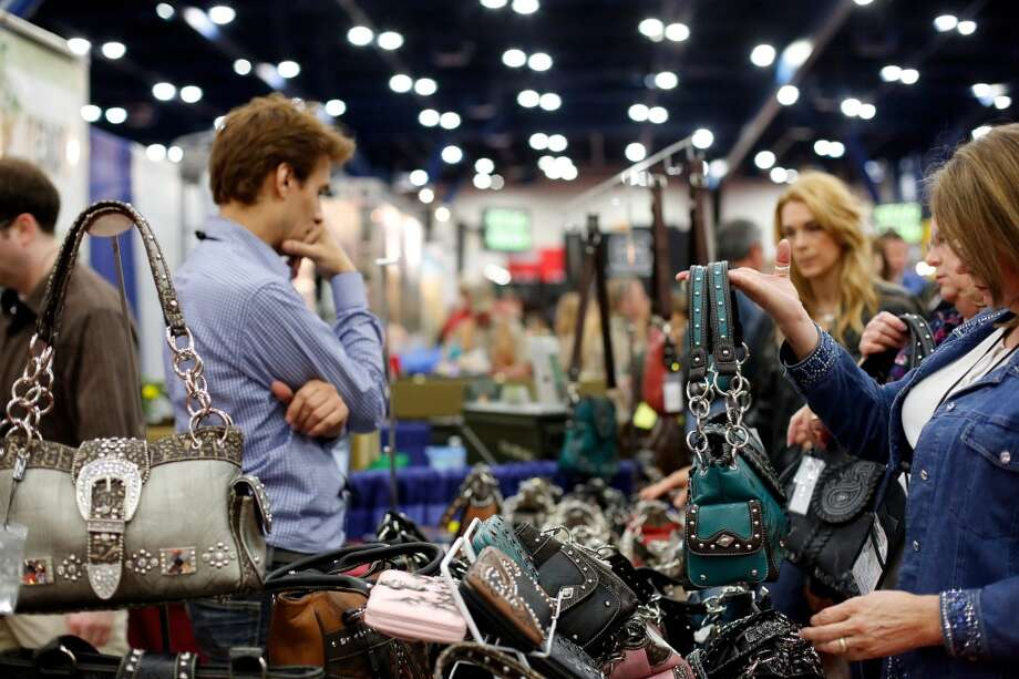 A festival attendee checks out a firearm handbag, during day 1 of the 142nd NRA annual meetings and exhibits, Friday, May 3, 2013 at the George R Brown convention center in  (TODD SPOTH FOR THE CHRONICLE) Photo: © TODD SPOTH, 2013