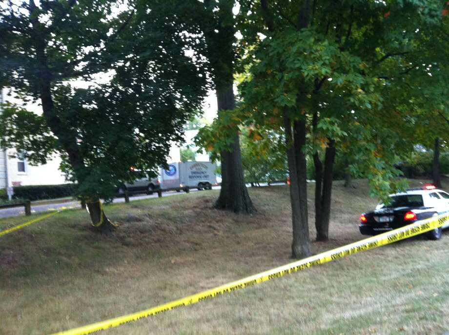 Officials remain on scene on Friday, Oct. 4, 2013 at the Woodside Green condominium complex where Capitol chase suspect and shooting victim Miriam Carey lived.  Photo: Christine Hall