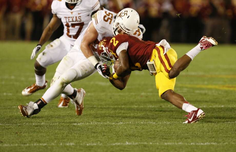 Linebacker Dalton Santos #55 of the Longhorns tackles running back Aaron Wimberly #2 of the Cyclones. Photo: David Purdy, Getty Images