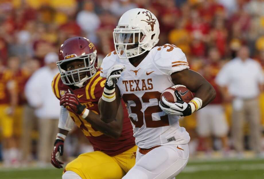 Running back Johnathan Gray #32 of the Longhorns drives the ball to the end zone for a touchdown. Photo: David Purdy, Getty Images