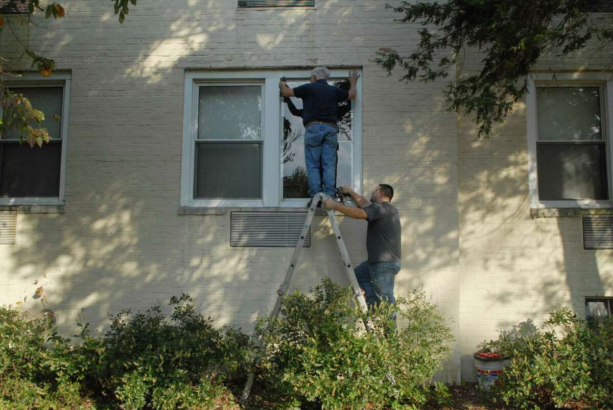 Workers replace the window in the Woodside Green Condominiums in Stamford, Conn. on Friday October 4, 2013 where Miriam Carey lived. Carey was killed on Thursday after she attempted to ram the White House gate Thursday afternoon and was chased by Capital police.