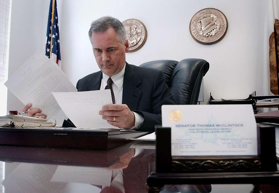 Republican candidate Tom McClintock works in his office in the state Capitol building in Sacramento August 19, 2003.  Photo: Tim Wimborne, REUTERS
