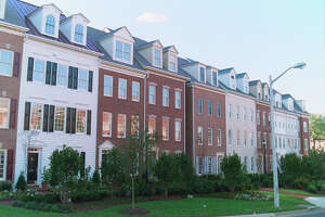 Bethesda, Md. based EYA's original 1996 version of its best selling 16 and 18-foot wide townhouses (second and third houses from the left) built in Alexandria, Va., featured the traditional, colonial styling that has been standard issue in the Washington area for decades.