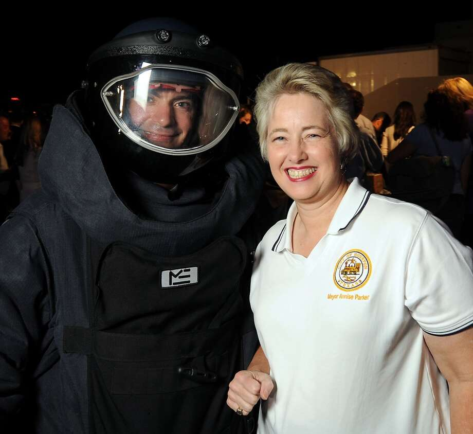 HPD bomb technician Lance Gibson with mayor Annise Parker at the HPD True Blue Gala benefitting the Houston Police Foundation at the Landry's Flight Hanger at Hobby Airport Saturday Oct. 20,2012. Photo: Dave Rossman, For The Houston Chronicle