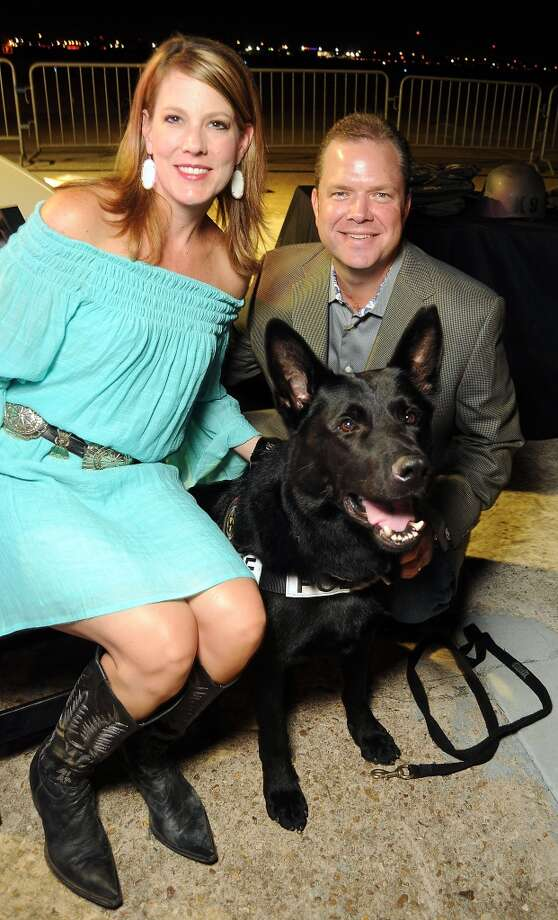 Kevin and Cheryl Ormston with a police dog at the HPD True Blue Gala benefitting the Houston Police Foundation at the Landry's Flight Hanger at Hobby Airport Saturday Oct. 20,2012. Photo: Dave Rossman, For The Houston Chronicle