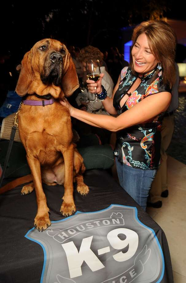 "Susan Kramer pets HPD Bloodhound ""Spirit"" at the Houston Police Foundation fundraiser at the home of Tilman Fertitta Saturday Oct. 22,2011. Photo: Dave Rossman, For The Chronicle"
