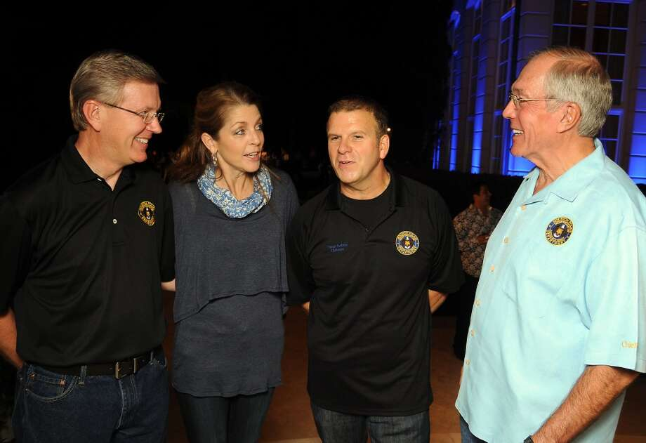 From left: Executive Assistant Police Chief Tim Oettmeier, Paige and Tilman Fertitta and John Nau at the Houston Police Foundation fundraiser at the Fertitta's home Saturday Oct. 22,2011. Photo: Dave Rossman, For The Chronicle