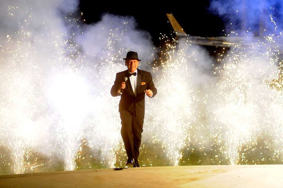 A Frank Sinatra impersonator makes an entrance at the Houston Police Foundation fundraiser at the home of Tilman Fertitta Saturday Oct. 22,2011. Photo: Dave Rossman, For The Chronicle
