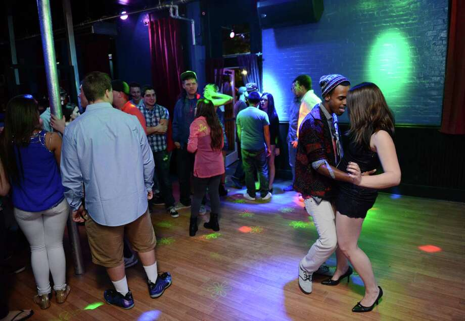 Club promoter Josh Adames dances with a guest during the grand opening of Skyy Bar & Lounge in Danbury, Conn. on Thursday, Oct. 3, 2013.The nightclub opened in the space long known as Tuxedo Junction, but closed after only a few months. Photo: Tyler Sizemore / The News-Times