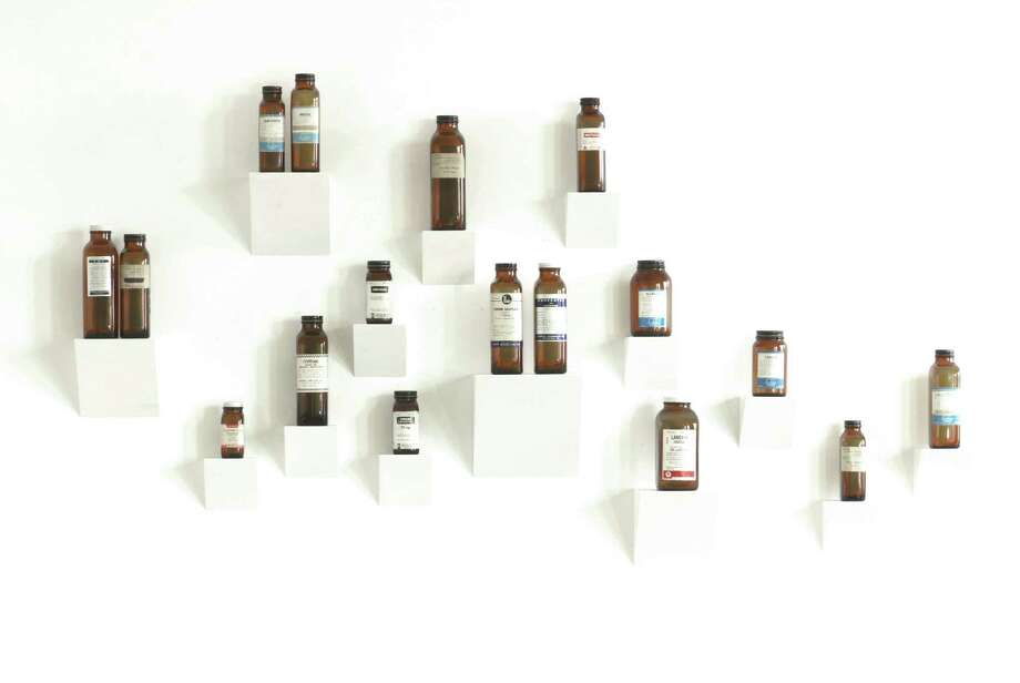 New York designer David Kassel's team at ILevel Studio uses collections of vintage medicine bottles and objets d'art to decorate walls. Photo: Associated Press