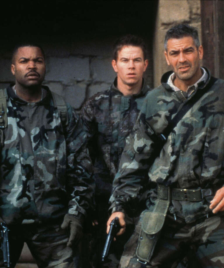 (From left) Ice Cube, Mark Wahlberg and George Clooney play Persian Gulf War soldiers plotting to steal gold from Saddam Hussein in the 1999 adventure movie ''Three Kings'' Saturday on NBC (8 p.m. ET).