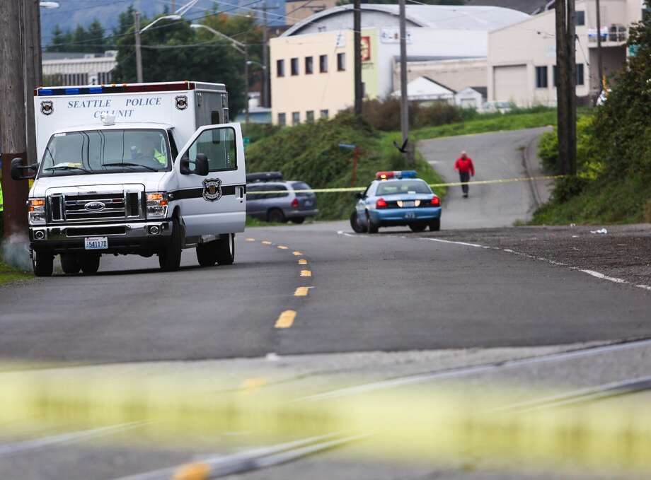 Crime scene investigators work an area where a woman was found dead in the 2400 block of North Northlake Way next to the Burke-Gilman trail. A neighbor said she heard a single gunshot sometime before 1:30 a.m. Photo: JOSHUA TRUJILLO/SEATTLEPI.COM / seattlepi.com