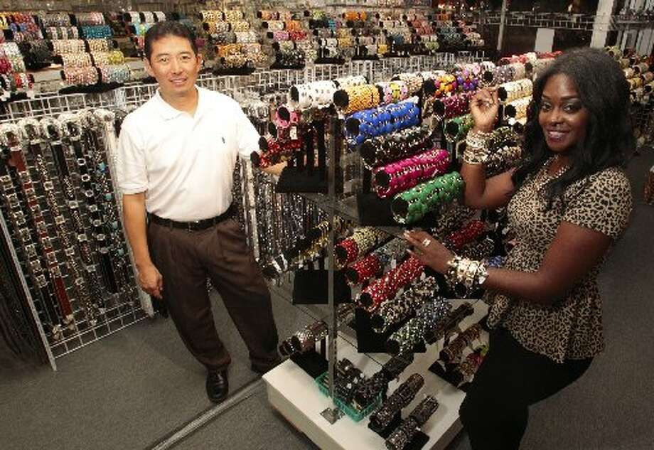 Bella Jewelry owner Sam Kim and Hucksters sales rep Dionell Blate, a.k.a. Mocca Couture. Photo: Billy Smith II