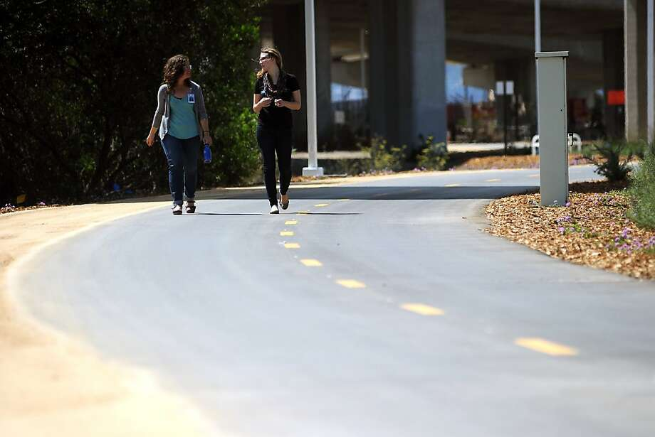 Khristina Wenzinger (left) and Lindsey Baker walk along the new east span bike path. Photo: Michael Short, Special To The Chronicle