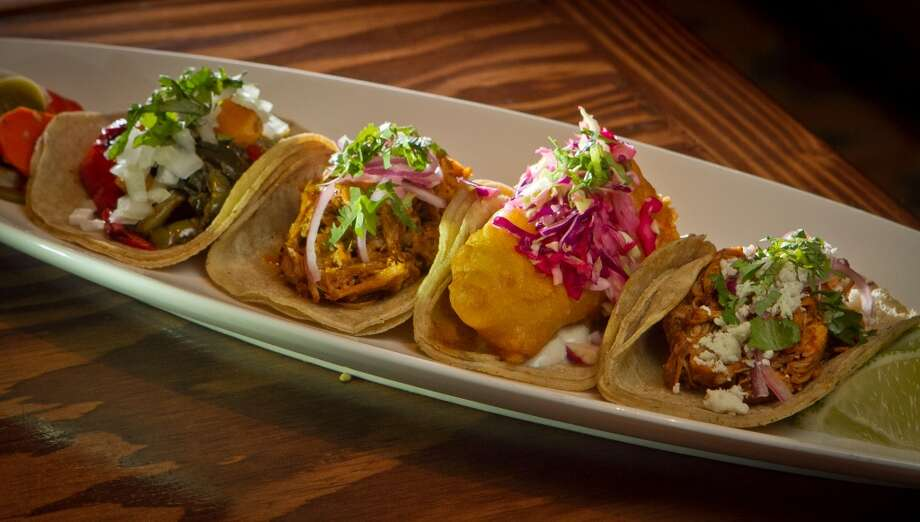 Tacos from left to right; Butternut Squash, Cochinita Pibil, Rock Cod, and Chicken en Mole Colorado at Tacolicious. Photo: John Storey