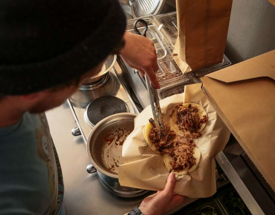 Jesse Wynn makes the Chomp Tacos at Chomp N Swig restaurant. Photo: John Storey, Special To The Chronicle