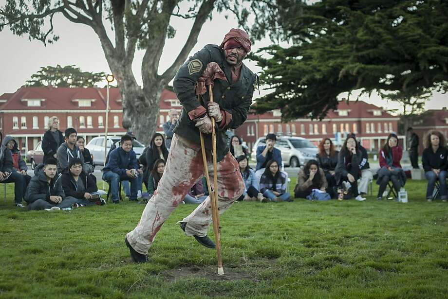 "Nikolas Strubbe is part of the ""Macbeth"" production created for its Fort Point setting. When it shifted hastily to the Presidio's Civil War Parade Ground Lawn, audiences shrank. Photo: Sam Wolson, Special To The Chronicle"