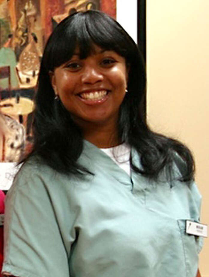 This 2011 photo provided by Dr. Barry Weiss, from the website of Advanced Periodontics in Hamden, Conn., shows former employee Miriam Carey. The 34-year-old Carey was shot to death by police after a car chase that began when she tried to breach a barrier at the White House. Photo: Contributed Photo, AP Photo/Advanced Periodontics / Stamford Advocate Contributed Associated Press