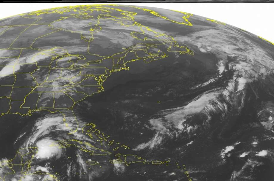 This NOAA satellite image taken Thursday, Oct. 3, 2013 at 1:45 a.m. EDT shows a tropical disturbance moving into the eastern Gulf of Mexico. Photo: Associated Press