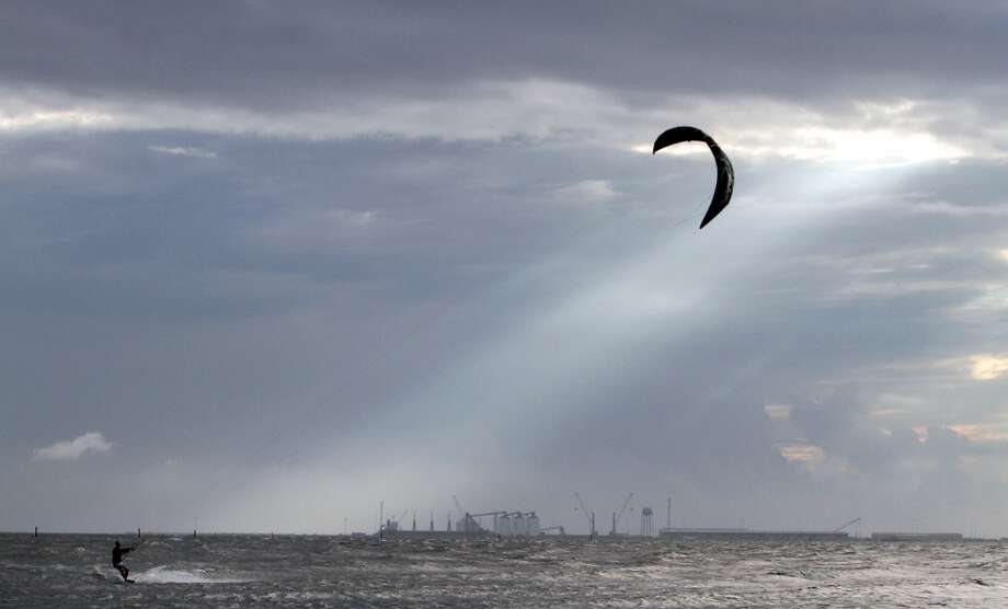 A kite boarder takes advantage of high winds on Thursday, Oct. 3, 2013, in Gulfport, Miss. Preparations are underway along the Mississippi coast as Tropical Storm Karen moves through the Gulf of Mexico. Photo: Amanda Mccoy, Associated Press