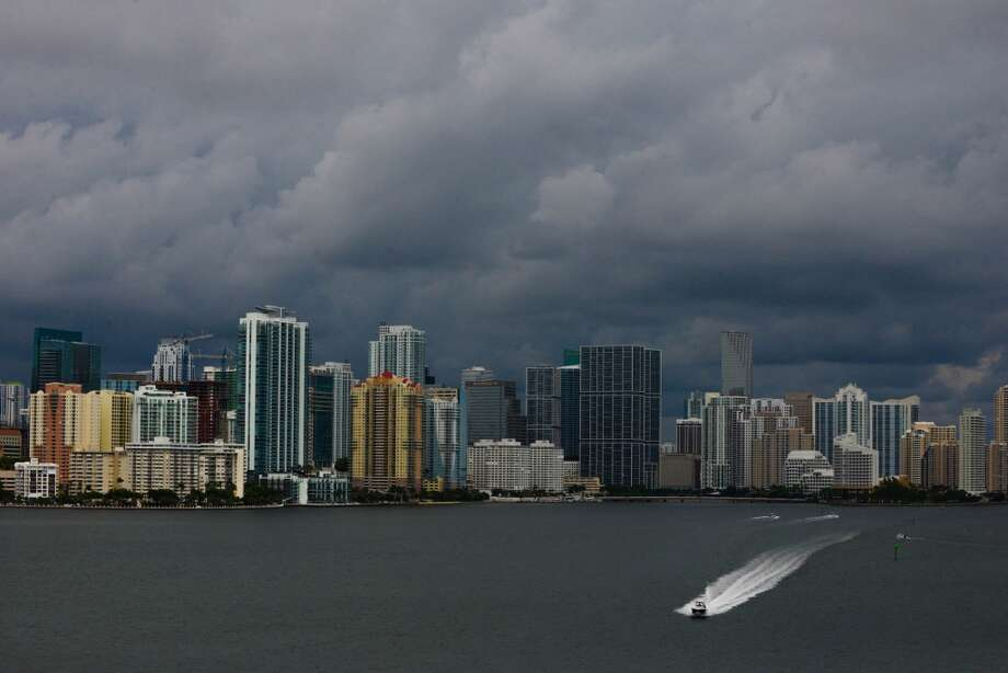 Downtown Miami, Florida, is shrouded in storm clouds as Tropical Storm Karen heads toward Florida's Panhandle on Thurdsay, October 3, 2013. Photo: Shannon Kaestle, McClatchy-Tribune News Service