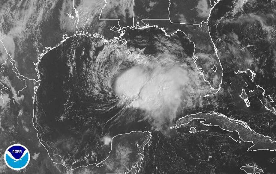 This image obtained from the National Oceanic and Atmospheric Administration (NOAA) shows Tropival Storm Karen in the Gulf of Mexico on October 4, 2013. Tropical Storm Karen churned toward the US Gulf Coast Friday, with forecasters warning of weekend flooding and heavy rainfall in several states, including Louisiana and Florida. As the system swirled about 250 miles (405 kilometers) south-southwest of the mouth of the Mississippi River, authorities urged residents to stock up on essentials. Through Sunday night, Karen was expected to dump up to 10 inches (25 centimeters) of rain in isolated areas, and three to six inches over parts of the central and eastern Gulf Coast. Photo: AFP/Getty Images