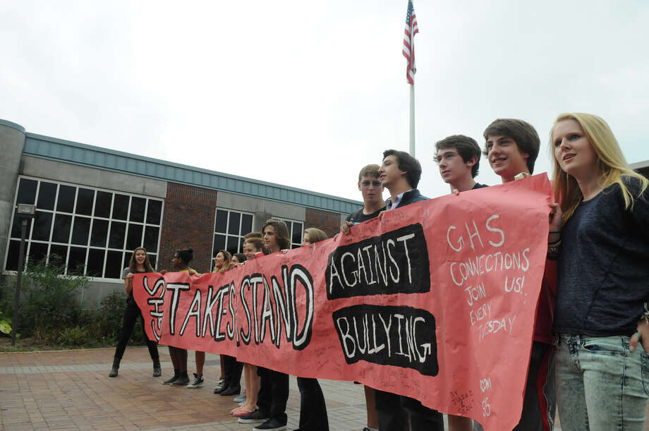 Greenwich High School students prepare for the arrival of students from Brien McMahon and Stamford High Schools as they all joined forces in a Bullying Awareness Walk which ended with a banner signing at Greenwich High School in Greenwich, Conn., October 4, 2013. Sixteen McMahon and Stamford students were greeted by their peers at Greenwich High after making the trek from Stamford High to Greenwich. The two groups exchanged banners and illustrated them together in a commitment to battle bullying. Photo: Keelin Daly / Stamford Advocate Freelance
