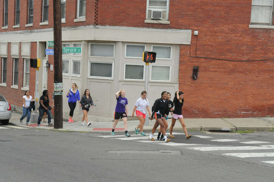 Students from Brien McMahon and Stamford High Schools walk through Stamford toward Greenwich as they participate in a Bullying Awareness Walk in Stamford, Conn., October 4, 2013. Sixteen McMahon and Stamford students were greeted by their peers at Greenwich High after making the trek from Stamford High to Greenwich. The two groups exchanged banners and illustrated them together in a commitment to battle bullying. Photo: Keelin Daly / Stamford Advocate Freelance