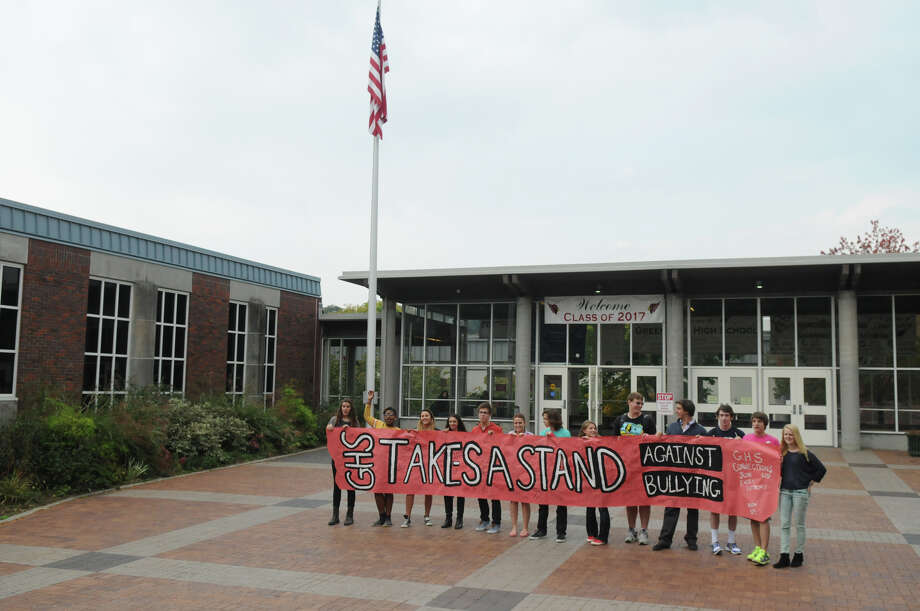 Greenwich High School students prepare to greet students from Brien McMahon and Stamford High Schools as the students joined forces in a Bullying Awareness Walk which ended with a banner signing at Greenwich High School in Greenwich, Conn., October 4, 2013. Sixteen McMahon and Stamford students were greeted by their peers at Greenwich High after making the trek from Stamford High to Greenwich. The two groups exchanged banners and illustrated them together in a commitment to battle bullying. Photo: Keelin Daly / Stamford Advocate Freelance