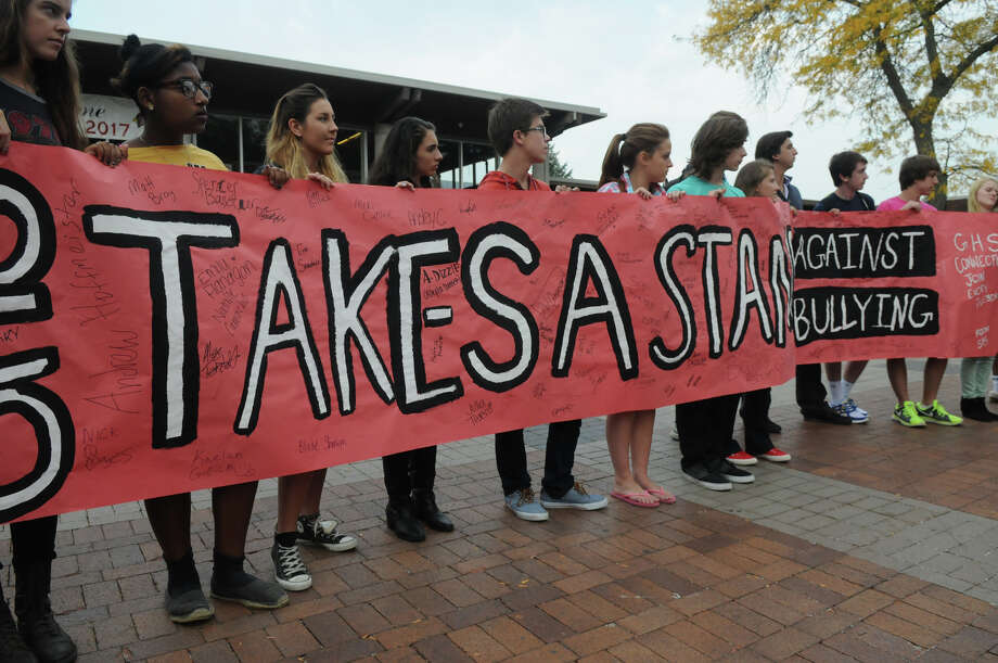 Students from Brien McMahon, Stamford and Greenwich High Schools joined forces in a Bullying Awareness Walk which ended with a banner signing at Greenwich High School in Greenwich, Conn., October 4, 2013. Sixteen McMahon and Stamford students were greeted by their peers at Greenwich High after making the trek from Stamford High to Greenwich. The two groups exchanged banners and illustrated them together in a commitment to battle bullying. Photo: Keelin Daly / Stamford Advocate Freelance