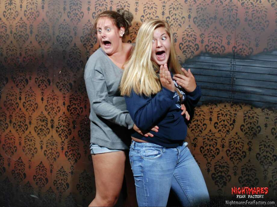 Guests at the Nightmares Fear Factory in Niagara Falls, Canada show shock and surprise in the haunted house in 2013. Photo: Nightmaresfearfactory.com