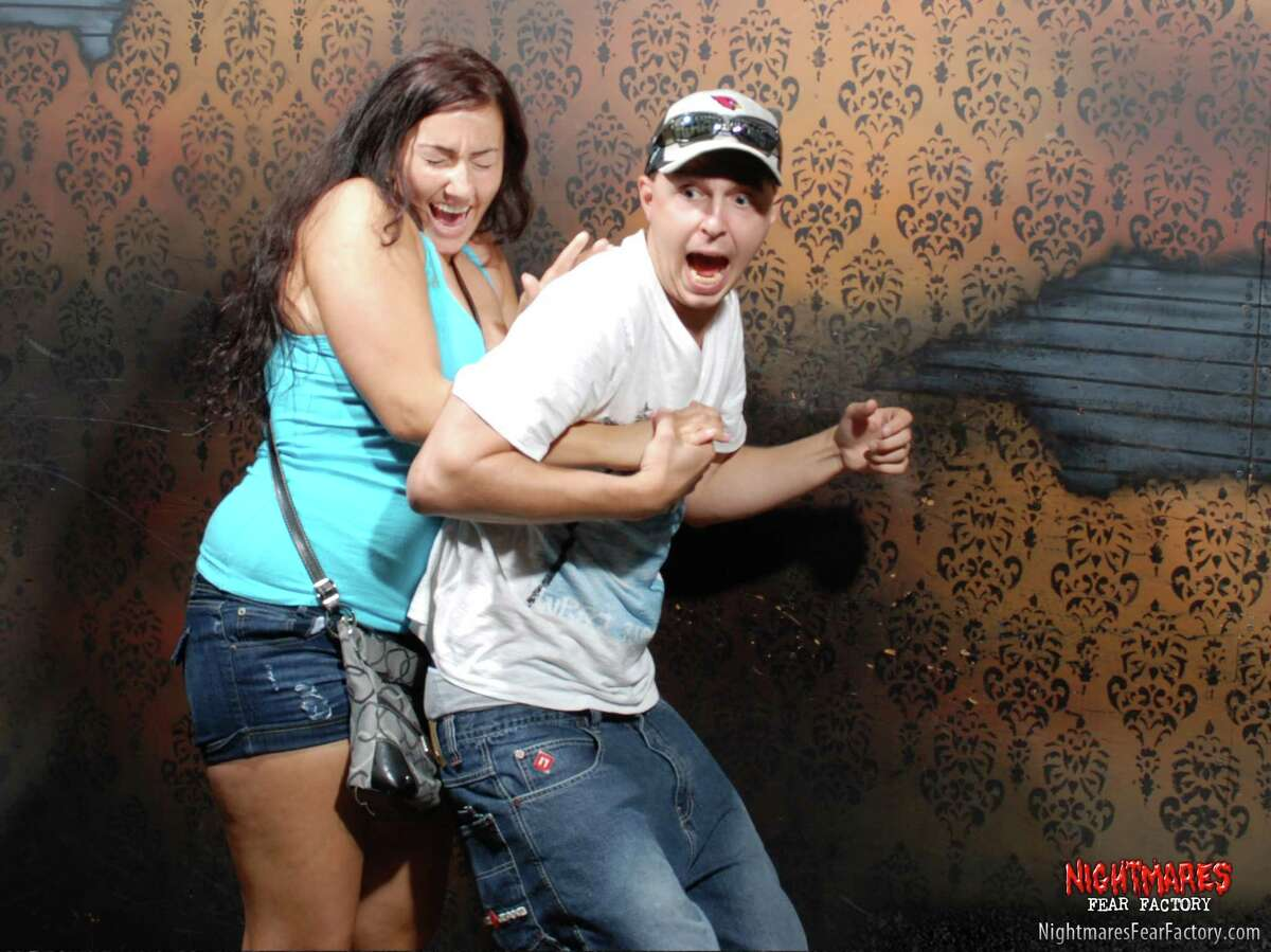 For the third straight year, Nightmares Fear Factory has released a set of photos of guests totally freaking out in their haunted house. It's our favorite thing about Halloween.