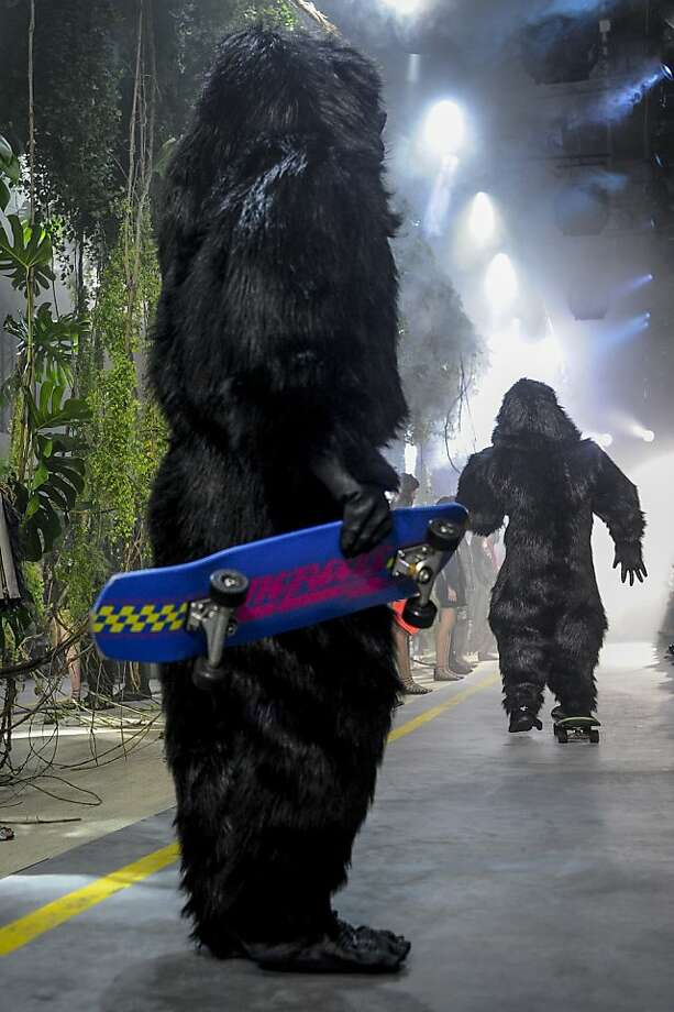 Haute couture head-scratcher:Models in gorilla suits skateboard down the runway during the Moncler ready-to-wear Spring/Summer 2014 fashion collection presented in Paris. Is it Halloween yet? Photo: Zacharie Scheurer, Associated Press