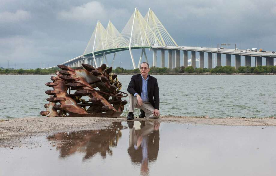 University of Houston professor Thomas M. Colbert believes levees at the Fred Hartman Bridge in Baytown could make the Ship Channel attractive to tourists and protect the area from hurricanes. (Craig H. Hartley/For the Chronicle) Photo: Craig Hartley, Freelance / Copyright: Craig H. Hartley
