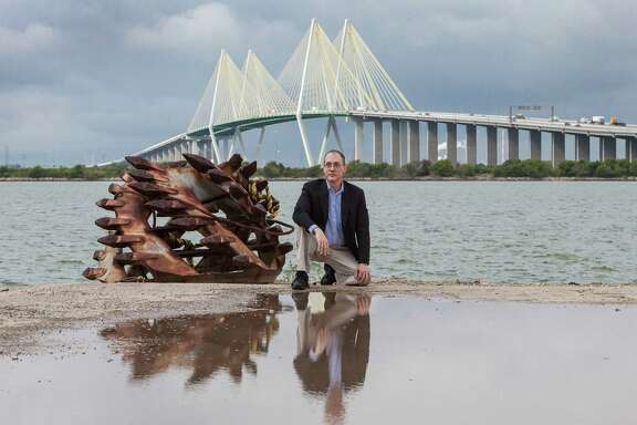 University of Houston professor Thomas M. Colbert believes levees at the Fred Hartman Bridge in Baytown could make the Ship Channel attractive to tourists and protect the area from hurricanes. (Craig H. Hartley/For the Chronicle)