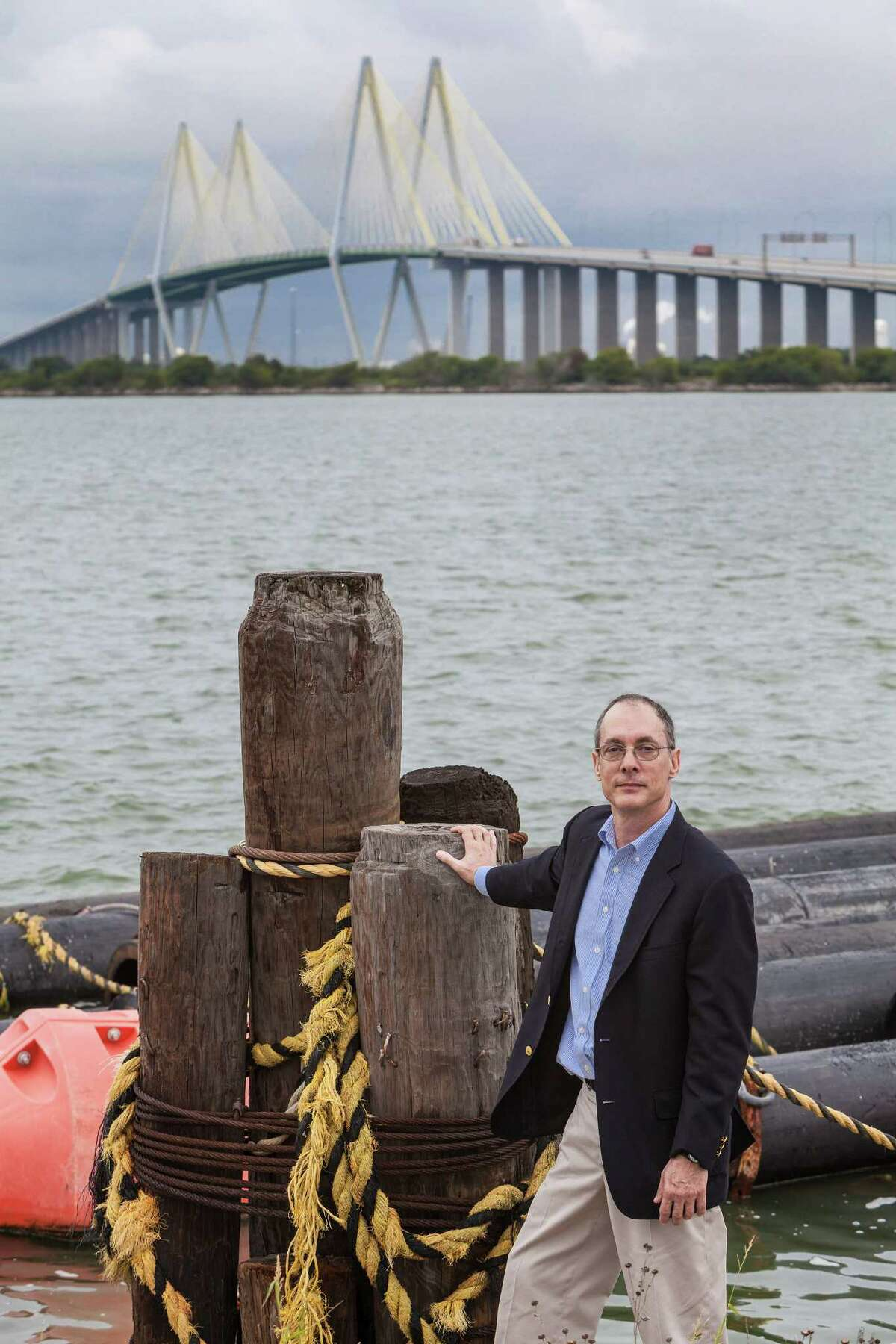 Thomas M. Colbert, Associate Professor from the Gerald D. Hines College of Architecture, UH, stands on the area northeast of the Fred Hartman Bridge, Baytown. He proposes a huge levy starting here and extending all the way across the Houston Ship Channel with giant gates to admit ship traffic under the Fred Hartman Bridge in the distance. 9/30/13 (Craig H. Hartley/For the Chronicle)