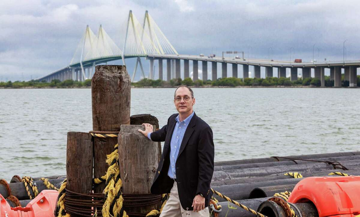 Tom Colbert in 2013, northeast of the Fred Hartman Bridge in Baytown. To protect the Houston Ship Channel from flooding, Colbert proposed a levee starting at that location and extending all the way across the ship channel, with giant floodgate that could be closed during storms.