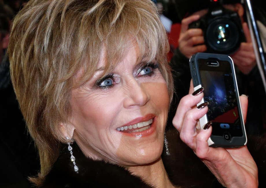 FILE - Actress Jane Fonda arrives for the screening of the film Promised Land at the 63rd edition of the Berlinale, International Film Festival in Berlin, Germany, in this Feb. 8, 2013 file photo. Fonda will receive the American Film Institute's 42nd Life Achievement Award, one of Hollywood's most prestigious career honors. The AFI award will be presented at a star-studded gala on June 5, 2014. (AP Photo/Gero Breloer, File) ORG XMIT: NY110 Photo: Gero Breloer / AP