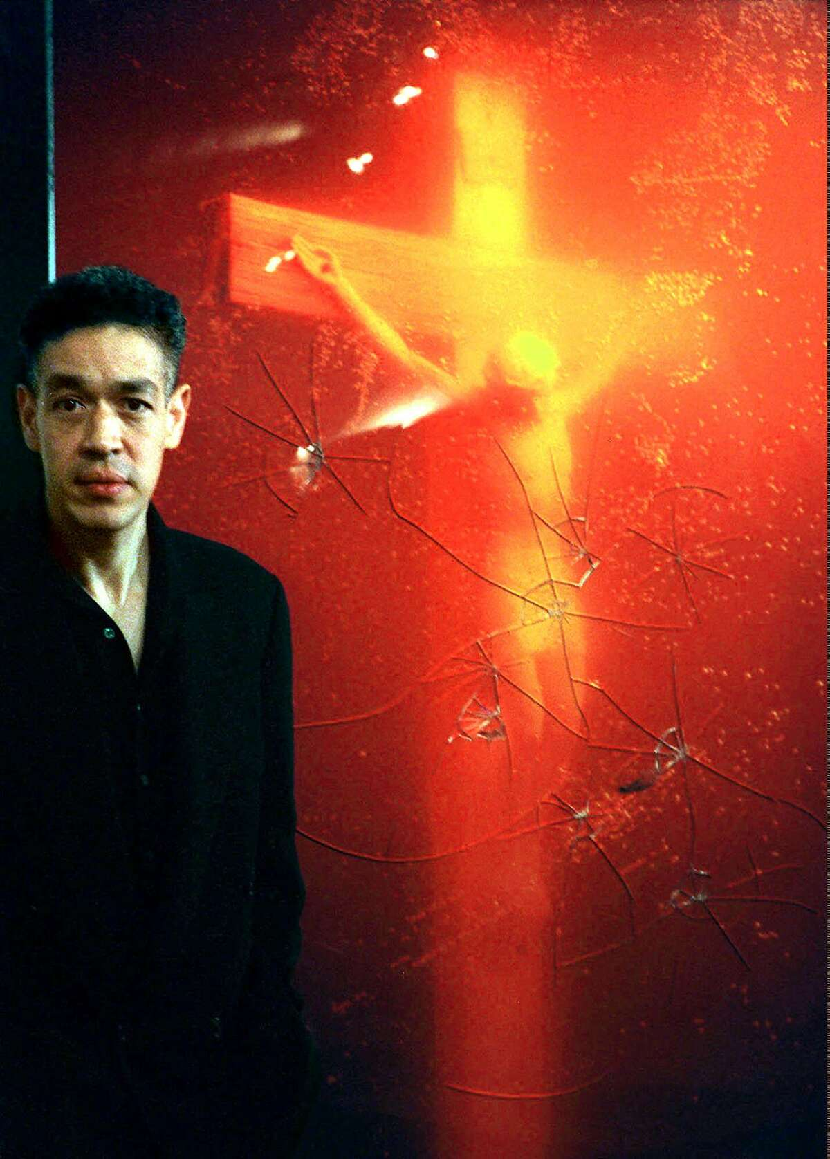 American photographer Andres Serrano's artwork 'Piss Christ,' which depicted a crucifix immersed in urine, saw his piece vandalized by Catholic activists. Source: Religion News Service