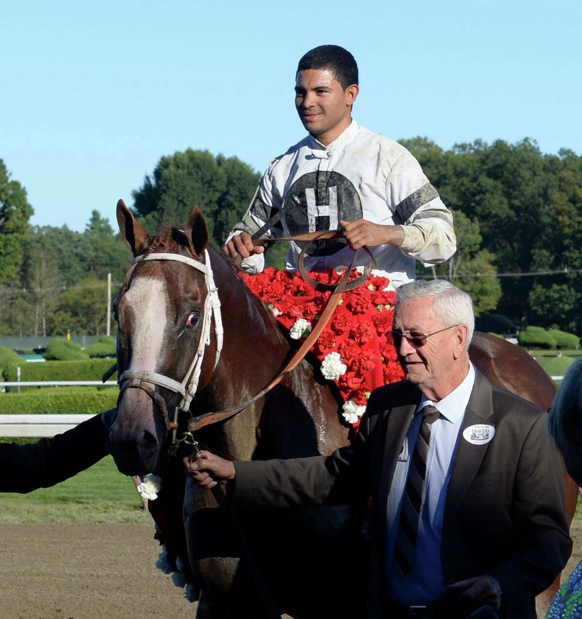 Will Take Charge with jockey Luis Saez is lead to the winner's circle by owner Willis Horton after winning the 144th running of The Travers Stakes, Aug. 24, 2013, at Saratoga Race Course in Saratoga Springs, N.Y. (Skip Dickstein/Times Union)
