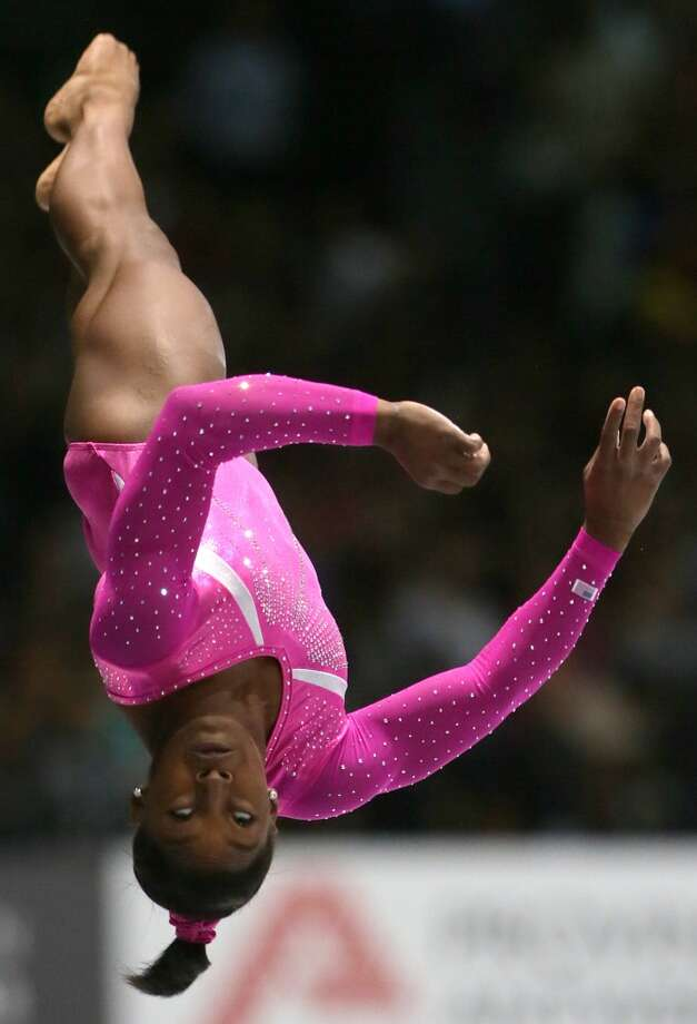 United States gymnast Simone Biles competes on the vault during an all-around final at the Artistic Gymnastics World Championships in Antwerp, Belgium. Photo: Virginia Mayo, Associated Press