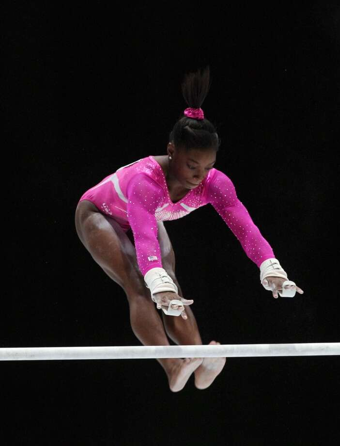 United States gymnast Simone Biles competes on the uneven bars during an all-around final at the Artistic Gymnastics World Championships in Antwerp, Belgium. Photo: Yves Logghe, Associated Press