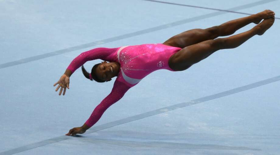 United States gymnast Simone Biles competes on the floor exercise during an all-around final at the Artistic Gymnastics World Championships in Antwerp, Belgium. Photo: Virginia Mayo, Associated Press