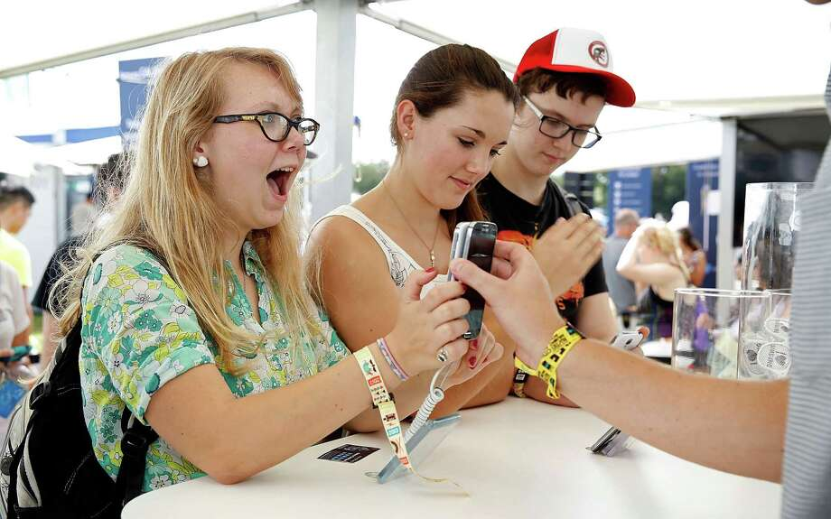 Attendees interact with Samsung devices at the Samsung Galaxy Experience during the Austin City Limits Music Festival on October 4, 2013 in Austin, Texas. Photo: Rick Kern, Getty Images For Samsung / 2013 Getty Images